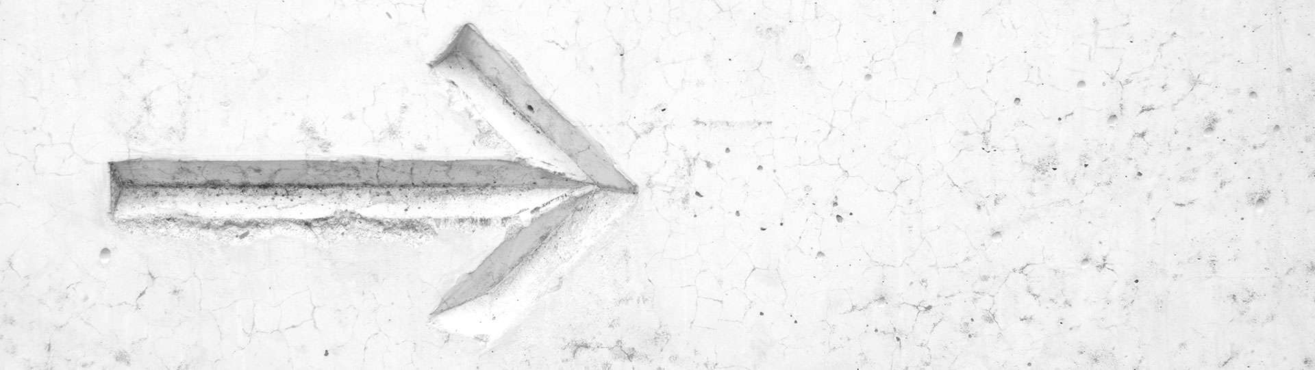 white arrow etched in stone