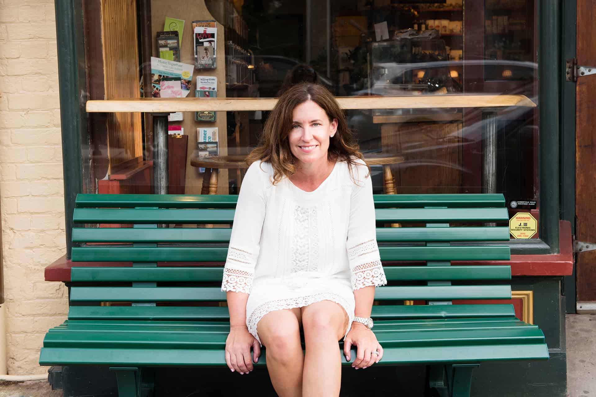 Kathy Marcino sitting on a green bench